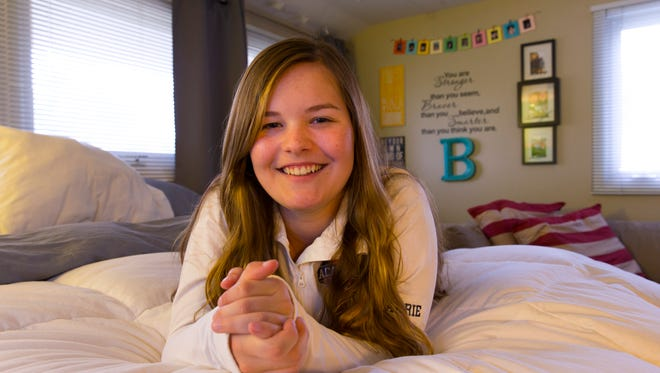 Barrett Poetker, a senior a Brookfield East High School, is working to start a chapter of REDgen at her school where students can support each other through struggles and mental health challenges.