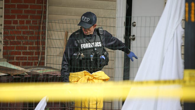 Wilmington police investigate the death of two children near the Trinity Vicinity in Wilmington Monday.