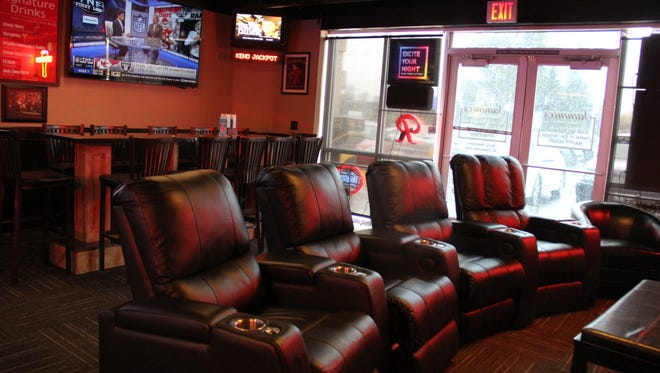 The couches at Sammies face a large television playing sports. The couches recline and have cupholders for beer, wine or cocktails.