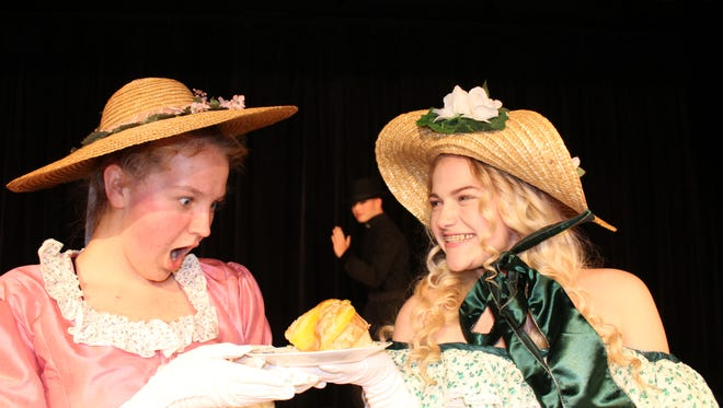 """Liberty Bundy (left) and Madison Knox prepare for the Stayton High School production of """"The Importance of Being Earnest."""""""