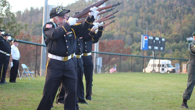 Members of the Disabled American Veterans Chapter 57 fired into the sky to honor the five local servicemen killed in the Vietnam War.