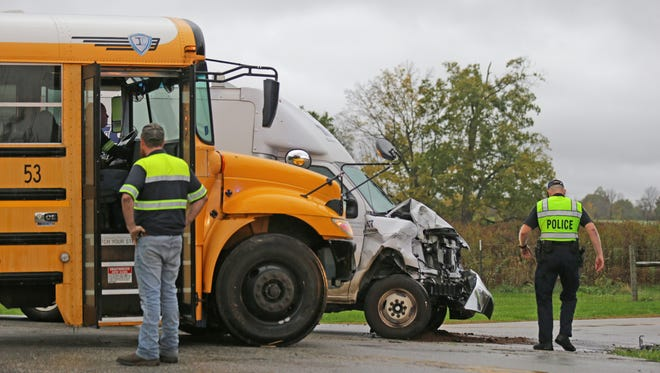 A R.T. Moore Plumbing Heating and Air Conditioning truck collided with a school bus carrying children from the Blue Academy in Decatur Township at the intersection of Ralston Rd. and Paddock Rd. on Monday, Oct. 23, 2017. Ten to twelve children were transported to the hospital as a precaution.