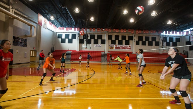West Oso volleyball players work on drills during their practice on Thursday, Oct. 27, 2017.