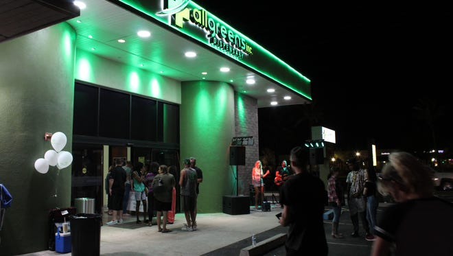 Customers line up outside of All Greens in Sun City as they open the first medicinal marijuana drive-thru in the state of Arizona on Oct. 27.