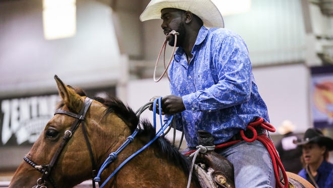 Shak Norris gets ready to ride during the 64th annual Roping Fiesta Sunday, Oct. 29, 2017, in the 1st Community Credit Union Spur Arena.