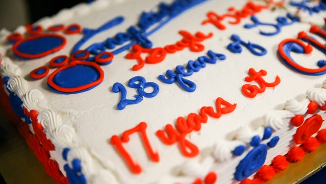 A cake is decorated for Gayle Bickel's retirement party Tuesday, Oct. 31, 2017, at Central High School.