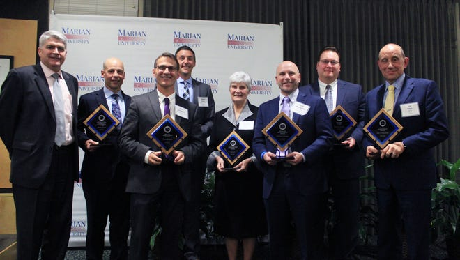 Winners at the 2017 Business & Industry Awards Ceremony are, from left:  Dr. Andrew Manion, president, Marian University; John Pfeifer, Mercury Marine; Tom Schneider, FCEDC/Envision FDL; Rob Zerjav, Wisconsin Timber Rattlers; Sr. Jean Steffes CSA, on behalf of Sr. Mary Mollison; Todd Huempfner, ACH Foam Technologies; Todd Koss, Grande Cheese Company; and James Eden, FDLAC/Envision FDL.
