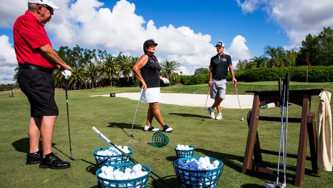 "LPGA legend Nancy Lopez, center, gives advice alongside former PGA Tour player Chris DiMarco, right, during a clinic before the ""Battle of the Sexes"" fundraiser for Swinging with a Purpose on Monday Nov. 6, 2017 at Quail West Golf and Country Club in Bonita Springs."
