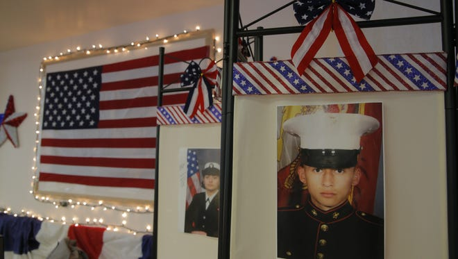 Pictures of military members on display at the cafeteria inside Salinas Valley Memorial Hospital.