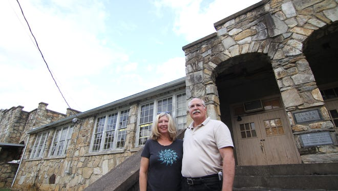 Brenda and George Maser stand outside the old Mars Hill High School Nov. 2, when they welcomed the public to learn more about their plans for the building.