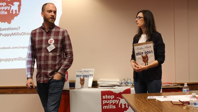Stop Puppy Mills Ohio field operations manager Karl Rusnak, left and Stop Puppy Mills Ohio campaign director Corey Roscoe discuss problems with puppy mills during a kick-off campaign meeting Thursday, Nov. 9, 2017. Stop Puppy Mils Ohio is collecting signatures to try to add an amendment to the state constitution to better regulate puppy mills.