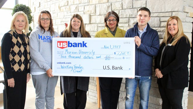 Marian University staff and students receiving donation form U.S. Bank Foundation. Pictured are, from left: Melanie Fox, U.S. Bank Administrative assistant; Christina Witthun, WFP, or Working Families Program student; Kerry Strupp, WFP director; Stacey Akey, vice president, Alumni, Career Services, and External Partnerships; Brennen Hacker, WFP student; Kim Schmitz, U.S. Bank, District retail manager.
