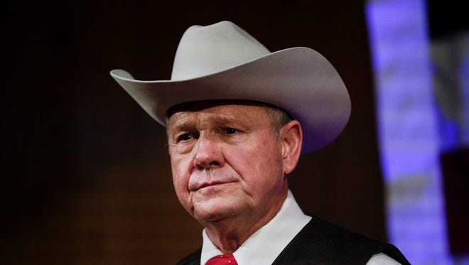 In this Sept. 25, 2017, file photo, former Alabama Chief Justice and U.S. Senate candidate Roy Moore speaks at a rally, in Fairhope, Alabama.