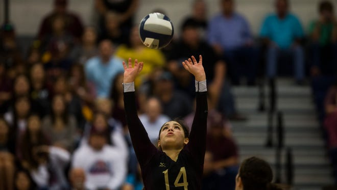 Tuloso Midway's Jazmine Perez sets the ball during the regional final match on Saturday, Nov. 11, 2017.