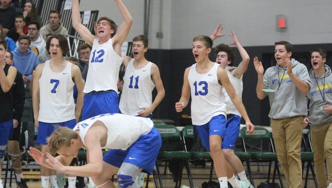 Germantown players celebrate a set-clinching point against Kaukauna in the WIAA boys volleyball state semifinal Nov. 11 at Wisconsin Lutheran College.
