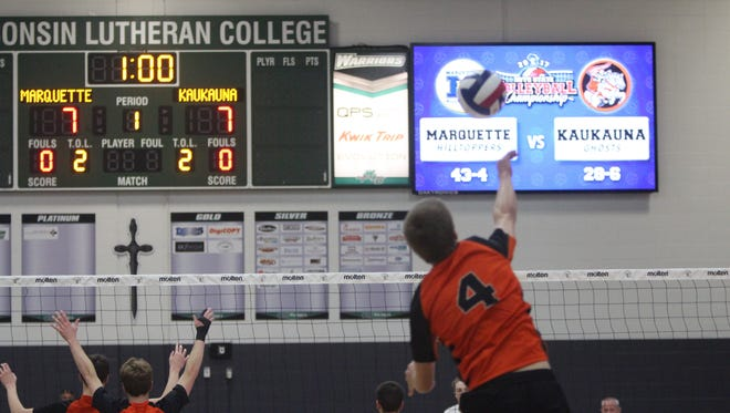 Noah Grinde serves to Marquette in the WIAA boys volleyball state final Nov. 11, 2017, at Wisconsin Lutheran College in Wauwatosa.