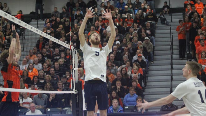 Conor Ward sets an attack for Marquette in the WIAA boys volleyball state final Nov. 11 at Wisconsin Lutheran College.