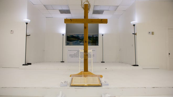 A cross was placed Sunday, Nov. 12, 2017, at the front of the sanctuary of First Baptist Church of Sutherland Springs in a memorial to the victims of the mass shooting that killed 25 people and an unborn child Nov. 5, 2017.