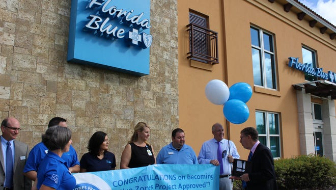 Florida Blue employees at Coconut Point celebrate their Blue Zones Project recognition.