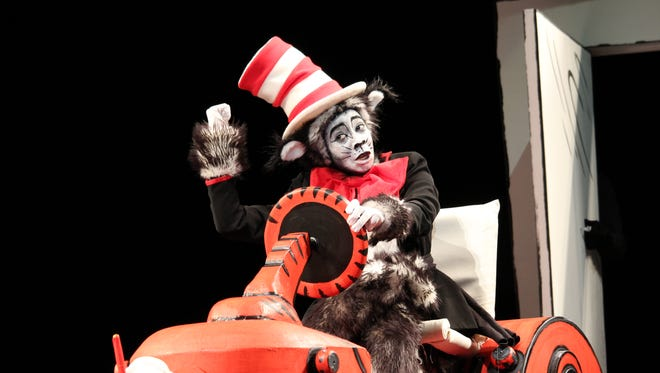 The Cat in the Hat (Veronica Nia) rides on and takes over FSU's stage.