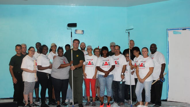 St. Lucie County Sheriff's Office & Boys & Girls Clubs employees helped renovate the Chuck Hill Clubhouse