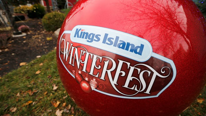 A giant Christmas tree bulb with the WinterFest logo is on display at Kings Island in Mason, Ohio, on Thursday, Nov. 16, 2017. Kings Island's WinterFest will run from Black Friday through the end of the year.