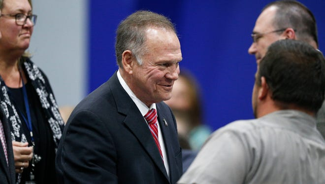 Former Alabama Chief Justice and U.S. Senate candidate Roy Moore walks out after he speaks at a revival, Tuesday, Nov. 14, 2017, in Jackson, Ala.