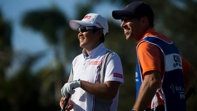 LPGA tour pro Peiyun Chien breaks a smile while speaking with her caddie on the ninth tee box during the first round of the CME Group Tour Championship at Tiburon Golf Club Thursday, Nov. 16, 2017 in Naples. Chien would finish the day tied for first place with a score of six-under par.