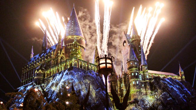 Hogwarts Castle is illuminated in a dazzling display using state-of-the-art projection mapping and lighting, as part of Universal Orlando's Holiday events. Photo by Christina LaFortune, Florida Today, 11/16/17.