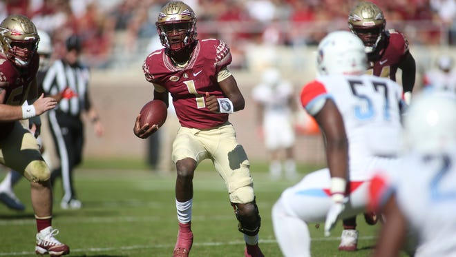 FSU quarterback James Blackman steals a look down the field during Florida State's 77-6 takedown of Delaware State Saturday.