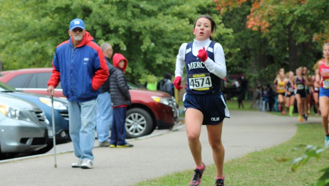 """Jack Dovi watches as his granddaughter Maddie passes during the 2015 McQuaid Invitational. """"I never saw that my father was there when I was taking this photo,"""" Marc Dovi said."""