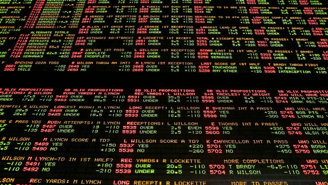 FILE – In this Jan. 27, 2015, file photo, Super Bowl proposition bets are displayed on a board at the Westgate Las Vegas SuperBook race and sports book in Las Vegas. The U.S. Supreme Court is set to hear arguments Dec. 4, 2017, as the state of New Jersey challenges a 1992 law forbidding state-authorized sports gambling in all but four states that met a 1991 deadline to legalize it: Delaware, Montana, Nevada and Oregon. (AP Photo/John Locher, File)