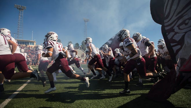 Calallen takes the field before their 5A Division II area round playoff game against Mercedes Friday, Nov. 24, 2017, at Javelina Stadium in Kingsville.