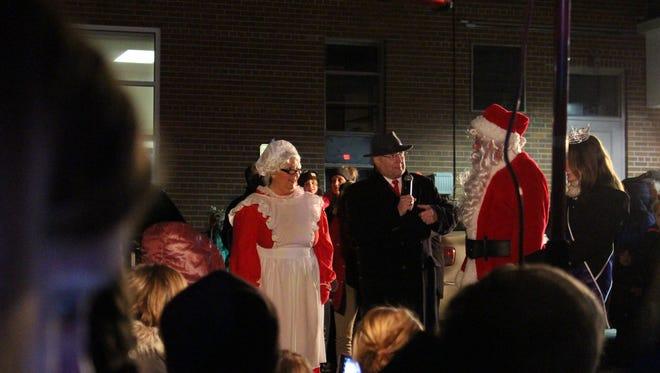 From left, Mrs. Claus, former Lexington Mayor Eugene Parkison, Santa Claus and Miss Lexington Grace Riegel talk to the crowd during the 2017 Light Up Lexington event.