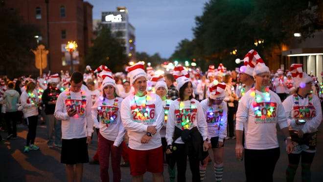 Runners hit Monroe Street downtown for the Jingle Bell Run during the City of Tallahassee 30th Annual Winterfest in 2016.