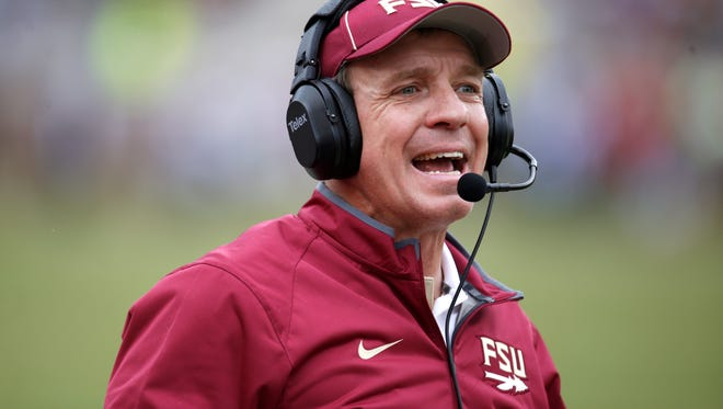 Head Coach Jimbo Fisher yells out to his team as the face USF at Doak Campbell Stadium on Saturday.