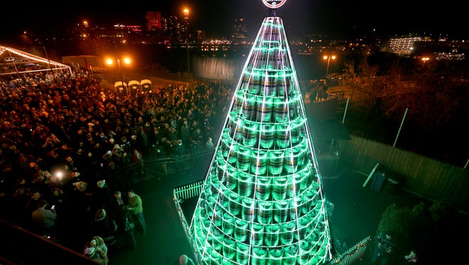 The annual three-story keg tree is lit at the Genesee Brew House.  More than 400 kegs stacked in 11 layers make up the 27-foot tree that has more than 2000 feet of lights.