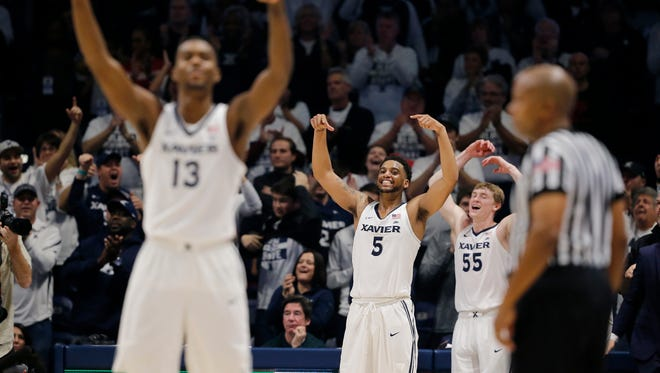 The Xavier Musketeers celebrate in the final minutes of the the second half of the 85th Annual Crosstown Shootout game between the Xavier Musketeers and the Cincinnati Bearcats at the Cintas Center in Cincinnati on Saturday, Dec. 2, 2017. The Musketeers won't the annual crosstown rivalry game, 89-76, dealing UC its first loss of the season.