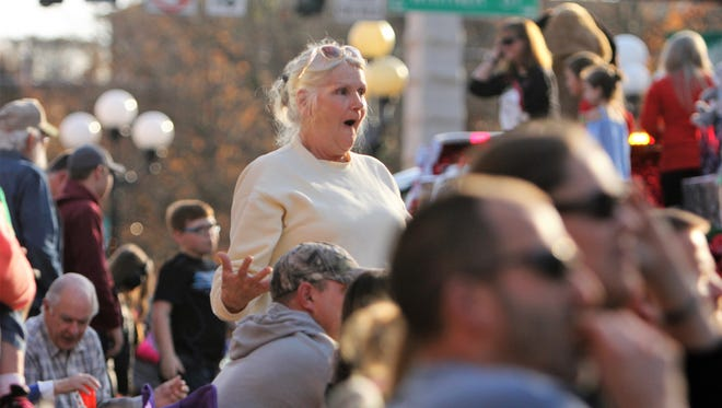 Rhonda Anusevitch hollers in joy during the Anderson Christmas Parade, she's been going for 47 years.