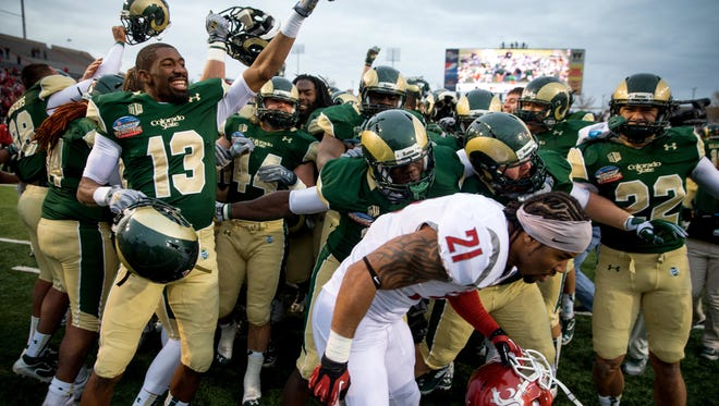 CSU football players celebrate their 48-45 victory over Washington State in the Gildan New Mexico Bowl in 2013.