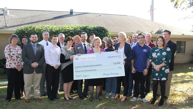 Tallahassee City Commissioner Nancy Miller and Southern Scholarship Foundation (SSF) Board Members, leadership and student representatives gather to receive a $25,000 donation from Origis Energy USA as presented by Natacha Standaert, manager of the company's Origis Energy Foundation program.