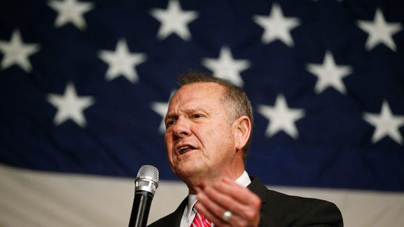 Former Alabama Chief Justice and U.S. Senate candidate Roy Moore speaks at a campaign rally, Tuesday, Dec. 5, 2017, in Fairhope, Ala. (AP Photo/Brynn Anderson)