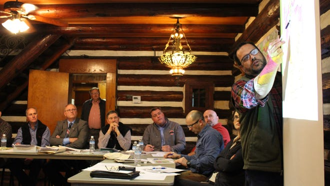Mohican forest manager Chad Sanders, far right, presents to the Forest Advisory Council, seated, on Thursday, Dec. 7, 2017. The council approved making several changes to a proposed five-year management plan for Mohican-Memorial State Forest.