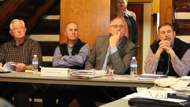 (From left to right) Forest Advisory Council chair Gary Kaster, member Eric Roush, Ohio Division of Forestry Chief Bob Boyles and council member Paul Mechling listen to a presentation from Mohican forest manager Chad Sanders during a Forest Advisory Council meeting Thursday, Dec. 7, 2017. The council approved making several changes to a proposed five-year management plan for Mohican-Memorial State Forest.