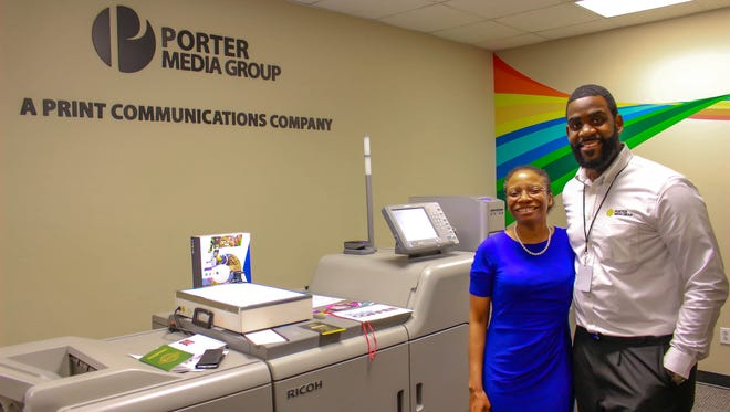 Ken Porter, owner of Porter Media Group in Detroit, stands with Detroit official Jill Ford. Porter received assistance for his business from the Entrepreneurs of Color fund created by JPMorgan Chase and W.K. Kellogg Foundation.