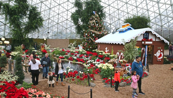 The Kooky Cooky House (right) is on display at the  Mitchell Park Domes as part of its Holiday Floral Show.