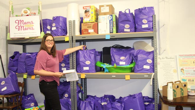 Program Manager Rebecca Tucker of Morristown with bags full of specific items requested by local families at Moms Helping Moms Foundation in North Plainfield.