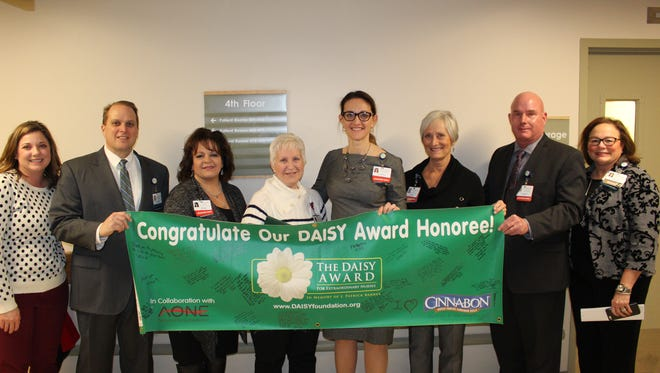 McLaren Greater Lansing nurse manager Kathy Dekker was honored with the DAISY Award for Extraordinary Nurses.