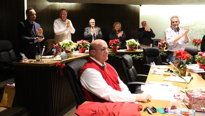 Mansfield City Council members and city officials applaud first-ward councilman Mike Hill during the Mansfield City Council meeting Tuesday, Dec. 19, 2017. Hill is retiring at the end of the year after 22 years on city council.