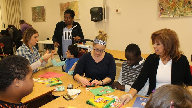 Kelly Adams, executive director of Arbor Terrace, took a day to volunteer and visited The Arc Kohler School in Mountainside to craft some handmade cards for troops serving overseas as part of the American Red Cross Holiday Mail for Heroes program.